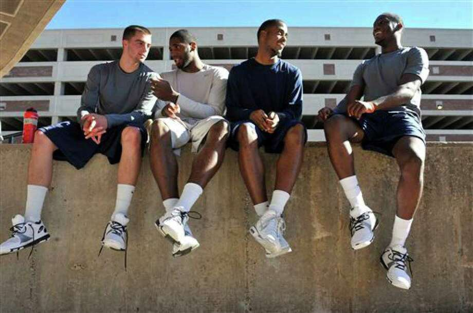 Connecticut basketball players, from left, Kyle Bailey,, Alex Oriakhi, Jamal Coombs-McDaniel and Donnell Beverly wait to be interviewed after the Husky Run in Storrs, Conn., Wednesday, Oct. 13, 2010.   (AP Photo/Jessica Hill) Photo: Jessica Hill, AP