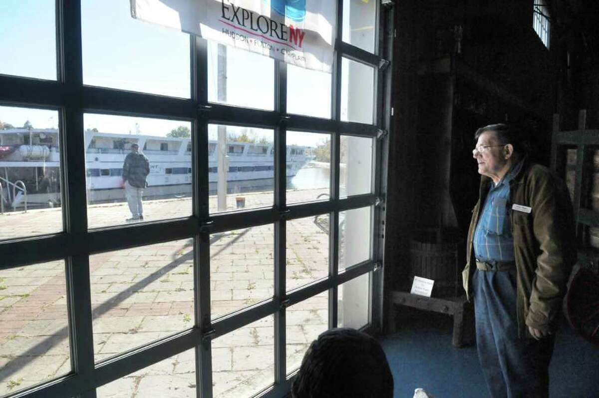 Tour guide Wayne Senecal watches as a tour boat pulls out after visiting the Skenesborough Museum, which displays artifacts from Whitehall's claim as the birthplace of the U.S. Navy. (Paul Buckowski / Times Union