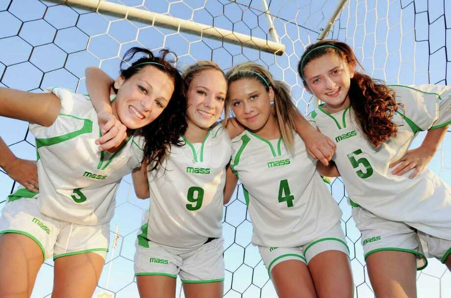 High school soccer -- Katie Saccocio, left, and her cousins, from left, Jenna, Hannah and Madeline, all are filling important roles with unbeaten Schalmont this season. The girls are following a family tradition. All of their dads played for the Sabres as well. (Luanne M. Ferris/Times Union) Photo: Luanne M. Ferris