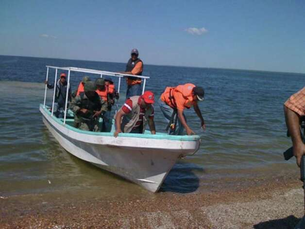 Members of the Mexican military search for David Hartley's body in Falcon Lake. The photo from last week was provided by the Webb County Sheriff's Office.