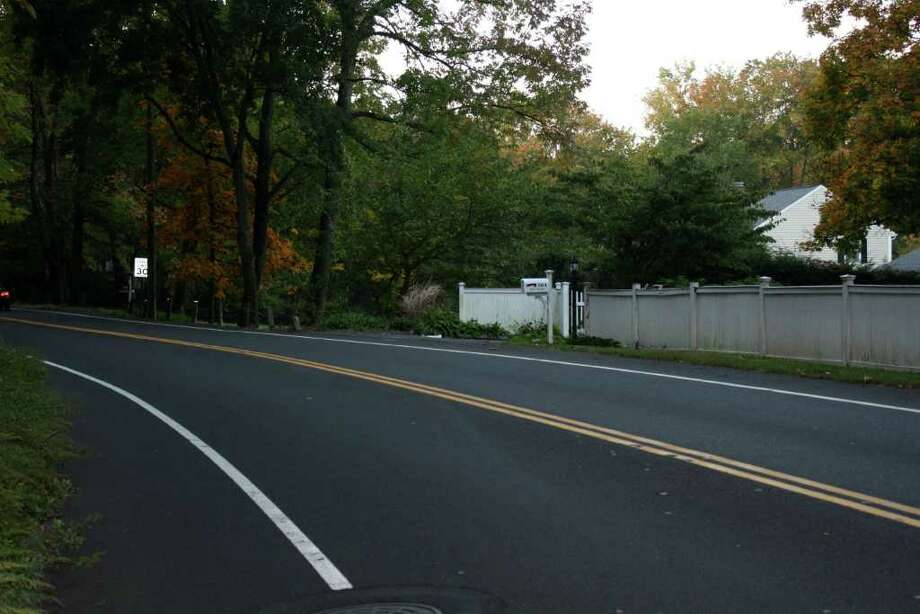 "This stretch of Hoyt Street is referred to as the ""death curve"" by Darien resident Holly Schulz because vehicles have a tendency to drive onto the shoulder where pedestrians are trying to walk. Photo: Ben Holbrook Contributed Photo, Contributed Photo / Darien News"