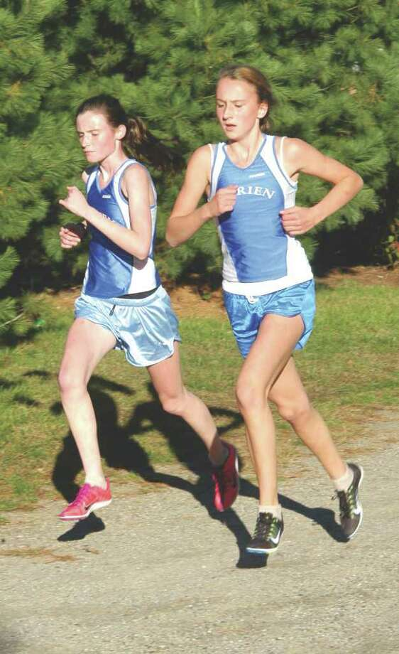 Sarah Colon, left, and Grace Loh pace themselves during Wednesday's meet at Fairfield Ludlowe. Photo: Contributed Photo / Andy Hutchison, Contributed Photo / Darien News