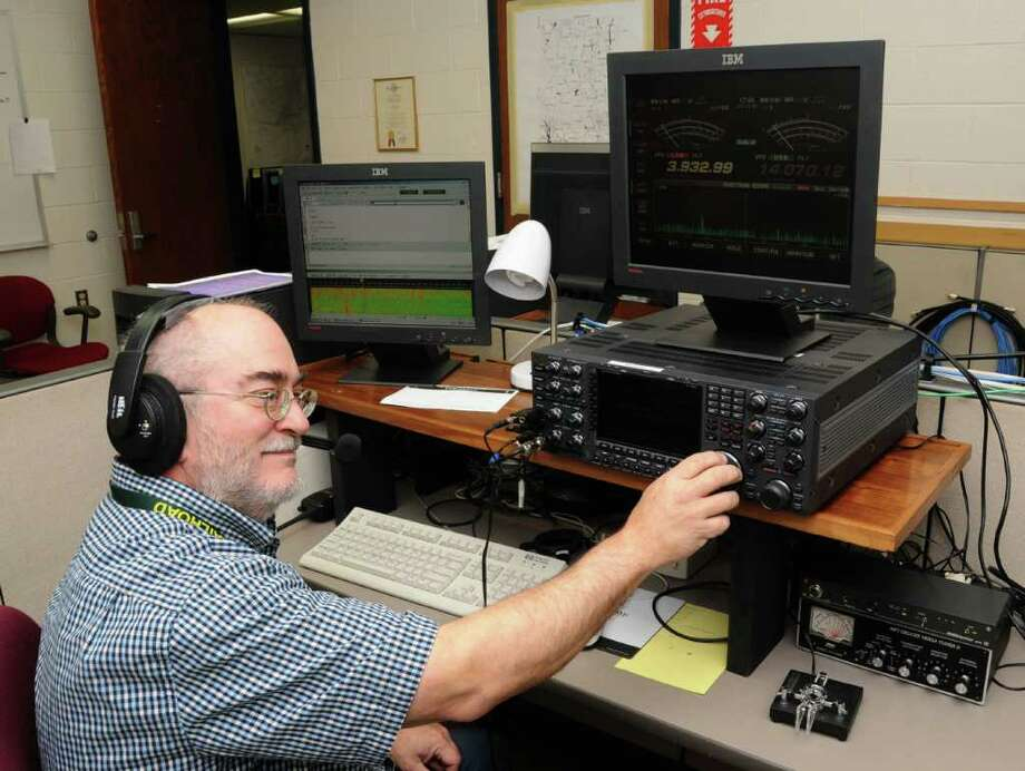 Harlan Ford, of Danbury, mans a ham radio at the Emergency Operations Center at Danbury City Hall, on Tuesday, Oct. 3, 2010. Photo: Jay Weir / The News-Times Freelance