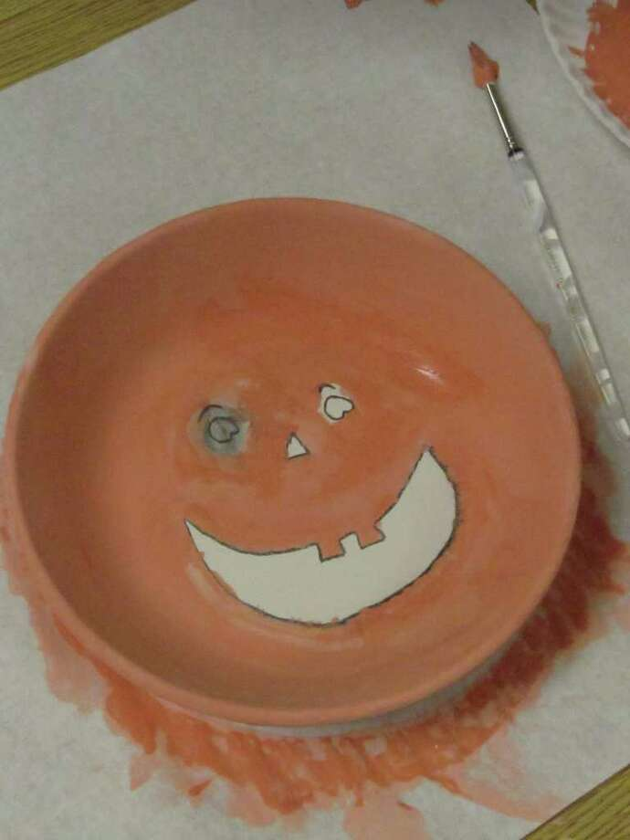 "Pictured is a candy bowl designed by Morgan Fisher, a 4th-grader a Jennings Elementary School. A pottery painting class, led by staff of Fairfield-based Hands On Pottery, is one of a multitude of offerings at Jennings Elementary School's ""After the Bell"" after-school program. Photo: Kirk Lang / Fairfield Citizen"