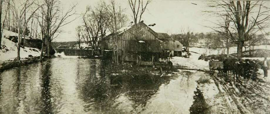 A vintage photograph of Wilson's Mill which once operated at the site of the current Easton Reservoir. Photo: Brian A. Pounds / Connecticut Post
