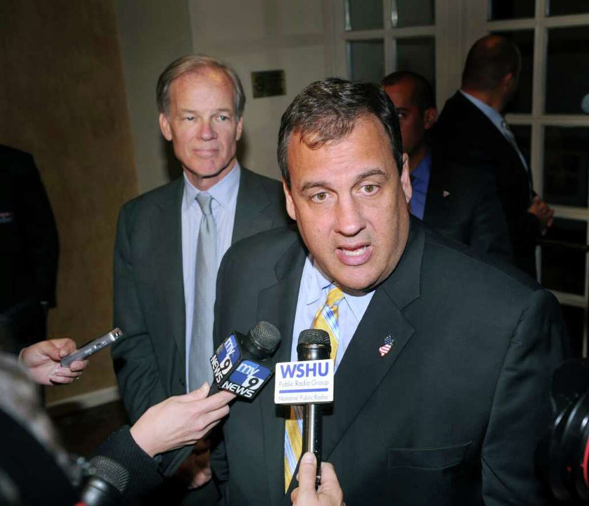 New Jersey Gov. Chris Christie, right, speaks with reporters during a campaign fundraising event for fellow Republican Tom Foley of Greenwich, left, who is running for governor of the state of Connecticut, Thursday night, Oct. 14, 2010 at the Hyatt Regency Hotel of Greenwich.