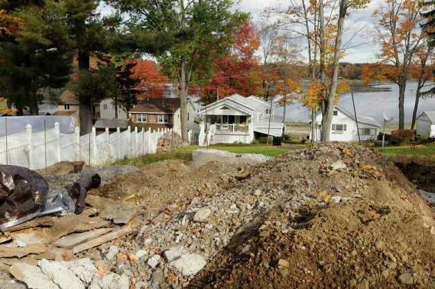 A construction project underway at a home on Galway Lake. Neighbors said the permit for the project expired. (Times Union / Michael P. Farrell) Photo: Michael P. Farrell
