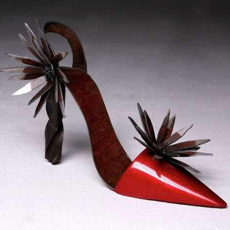 """Red Steel Hi-Heel,"" by Diana (Micki) Shampang-Voorhies. 2008, scrap steel, drill bit, automotive paint. Image courtsey of the artist. Photo by Overlay Photography."
