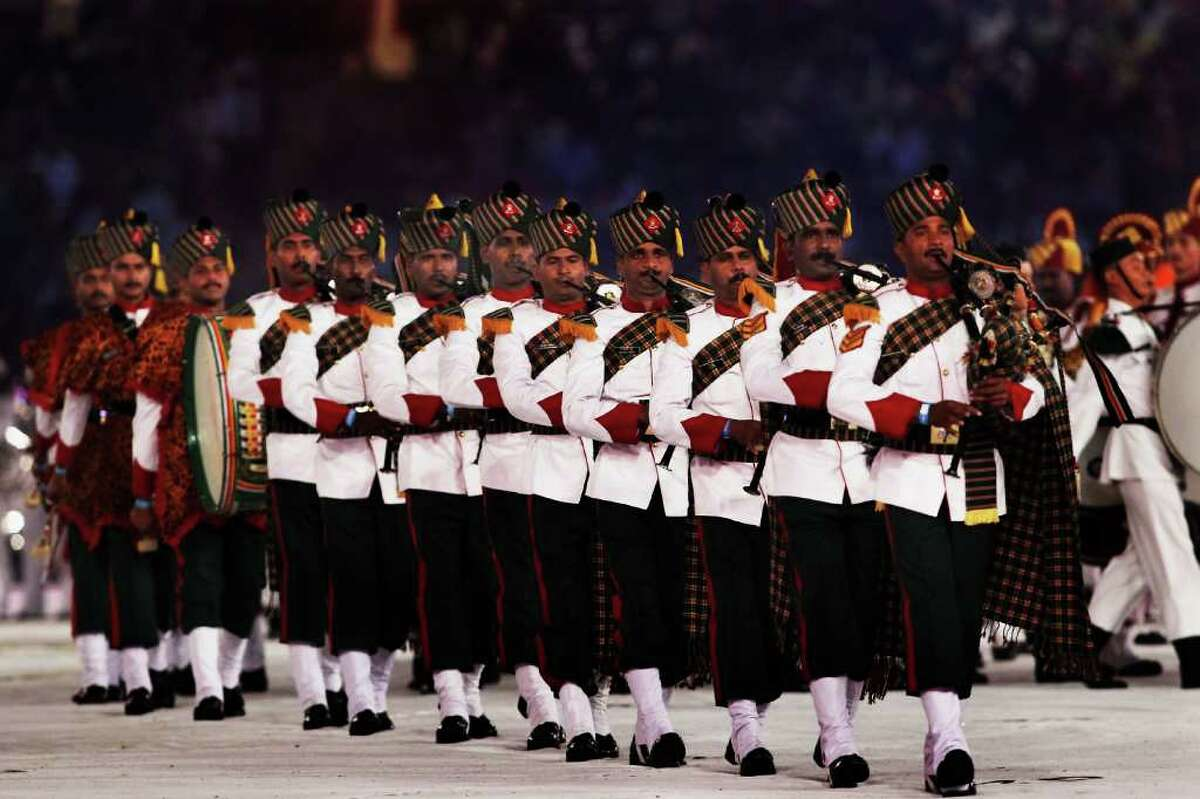 DELHI, INDIA - OCTOBER 14: Members of the Inidan military perform during the Closing Ceremony for the Delhi 2010 Commonwealth Games at Jawaharlal Nehru Stadium on October 14, 2010 in Delhi, India. (Photo by Daniel Berehulak/Getty Images)