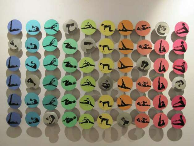 """Helen Zajkowski's """"Color Me Beautiful,"""" a comment on America's preoccupation with dieting, features images on discs of Jane Fonda in numerous exercise poses. The work is featured in Kinetic Art, a whimsical exhibition for children and adults that runs through Nov. 6 at Bridgeport's City Lights Gallery. Photo: CONTRIBUTED PHOTO"""