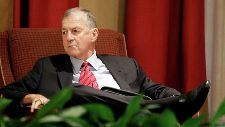 University of Connecticut men's basketball coach Jim Calhoun waits for the start of a hearing before the NCAA infractions committee in Indianapolis, Friday, Oct. 15, 2010. Connecticut has acknowledged the program committed major NCAA recruiting violations and has imposed its own sanctions, including two years' probation and a loss of one scholarship for the next two seasons. Photo: Darron Cummings, AP / AP