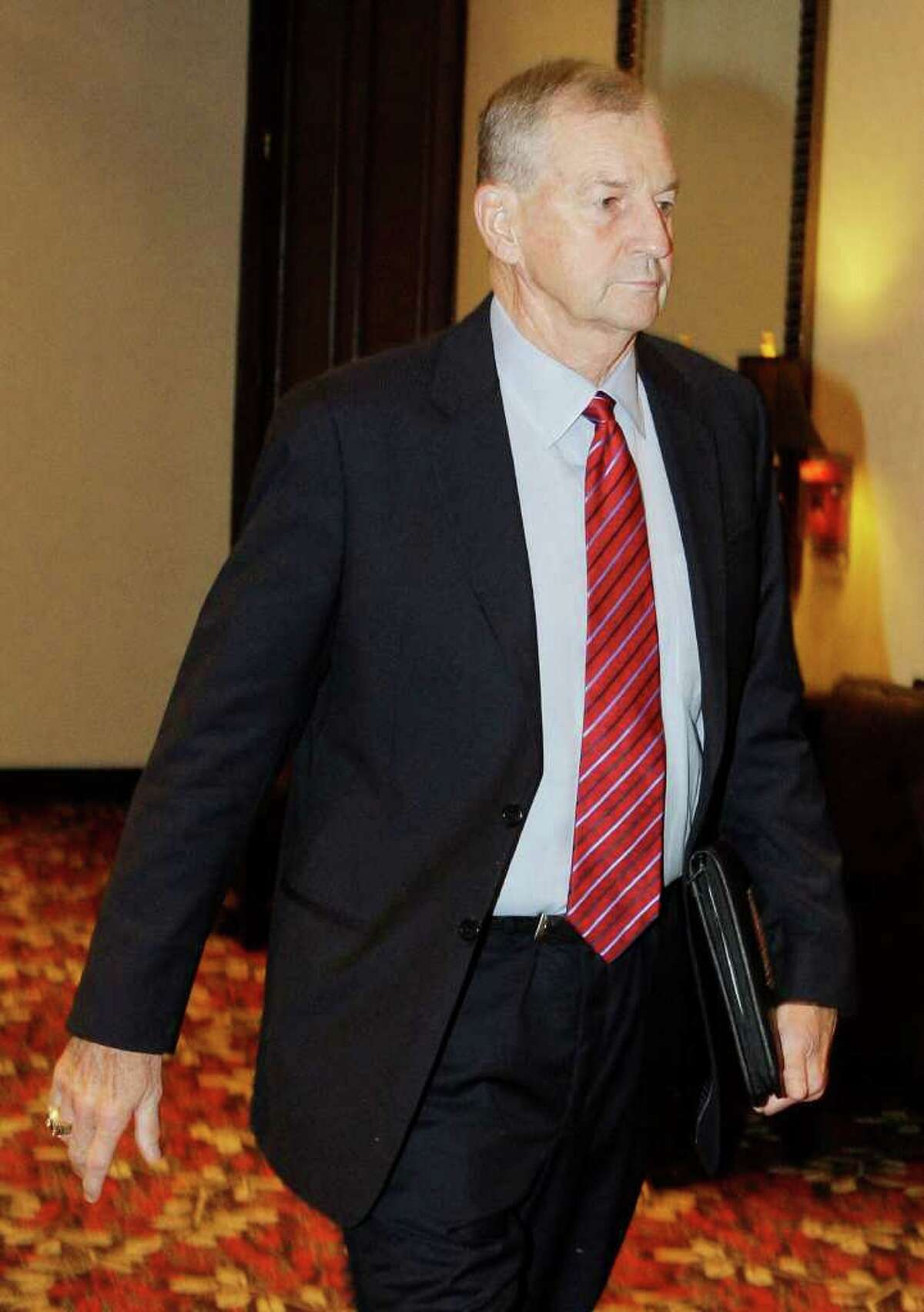 University of Connecticut men's basketball coach Jim Calhoun arrives for the start of a hearing before the NCAA infractions committee in Indianapolis, Friday, Oct. 15, 2010. Connecticut has acknowledged the program committed major NCAA recruiting violations and has imposed its own sanctions, including two years' probation and a loss of one scholarship for the next two seasons.