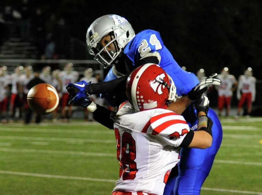 Masuk's #38 Kevin Costello disrupts a pass meant for Bunnell's #24 David Camille, during SWC football action in Stratford, Conn. on Friday October 15, 2010. Photo: Christian Abraham / Connecticut Post