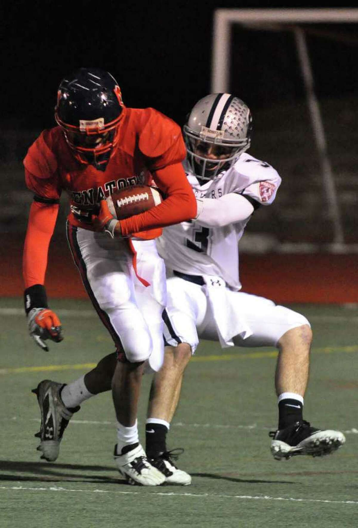 Staples' Jason Mawicke brings down Brien McMahon's Clement Abonyi during the football game at McMahon in Norwalk on Friday, Oct. 15. 2010.