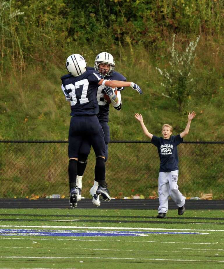Immaculate #26 - Dustin Robbins jumps for joy after scoring a touchdown against New Fairfield on Saturday, Oct 16, 2010. Photo: Michael Duffy / The News-Times
