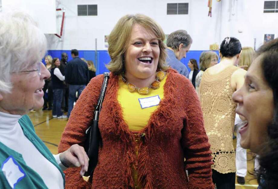 Kris Stone of Delaware, center, shares a laugh with her former Parkway School teacher Laura Fabel, right, at Parkway School, Greenwich, during the 50th birthday celebration for the school, Saturday, Oct. 16, 2010.  At left is Stone's mother, Louisa Stone of Greenwich, who was one of the organizers of the event. Photo: Bob Luckey / Greenwich Time