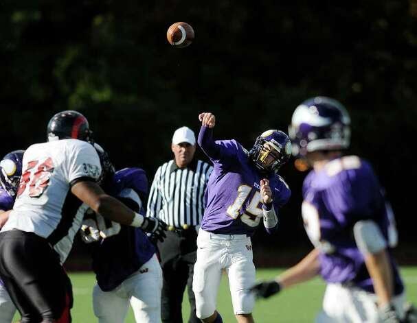 Westhill quarterback Peter Cernansky throws a pass as Westhill High School hosts Central High School in varsity football in Stamford CT on Saturday, October 16, 2010. Photo: Shelley Cryan / Shelley Cryan freelance; Stamford Advocate Freelance