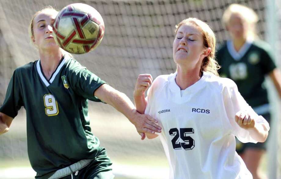 Hannah Withiam, # 9 of Greenwich Academy, left, in action against Jenna Frank, # 25 of Rye Country Day School, right, during girls soccer match between Greenwich Academy vs. Rye Country Day School at Greenwich Academy, Saturday, Oct. 16, 2010.  GA won the match, 1-0. Photo: Bob Luckey / Greenwich Time