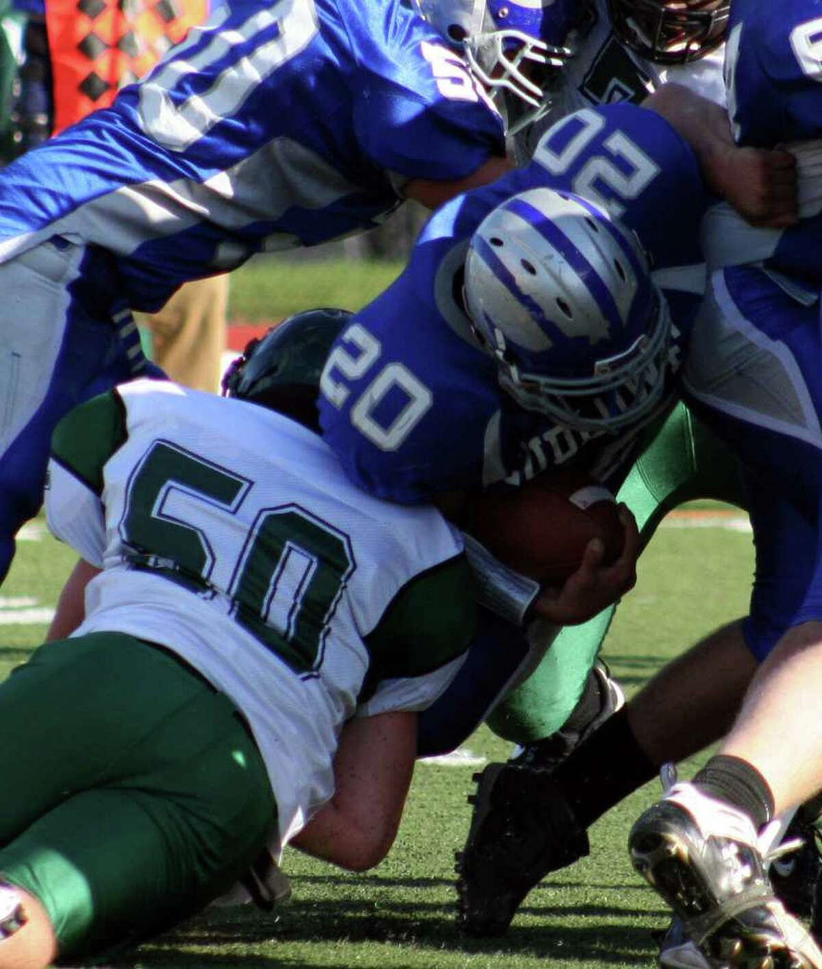 Norwalk linebacker Patrick Whalen tackles Ludlowe's Patrick Ferrio in the Bears' 24-13 win over the Falcons on Saturday, Oct. 16 at Taft Field.