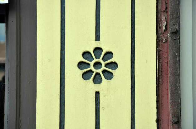 Yellow cast iron detailing on a brownstone building on Atlantic Street as seen during a tour of historic downtown Stamford on Saturday, Oct. 16, 2010. Photo: Amy Mortensen / Connecticut Post Freelance