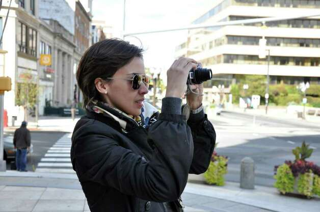 Nadia Martinez, of Greenwich, snaps a photograph of the Old Town Hall building on Atlantic Street during a walking tour of historic downtown Stamford on Saturday, Oct. 16, 2010. Photo: Amy Mortensen / Connecticut Post Freelance