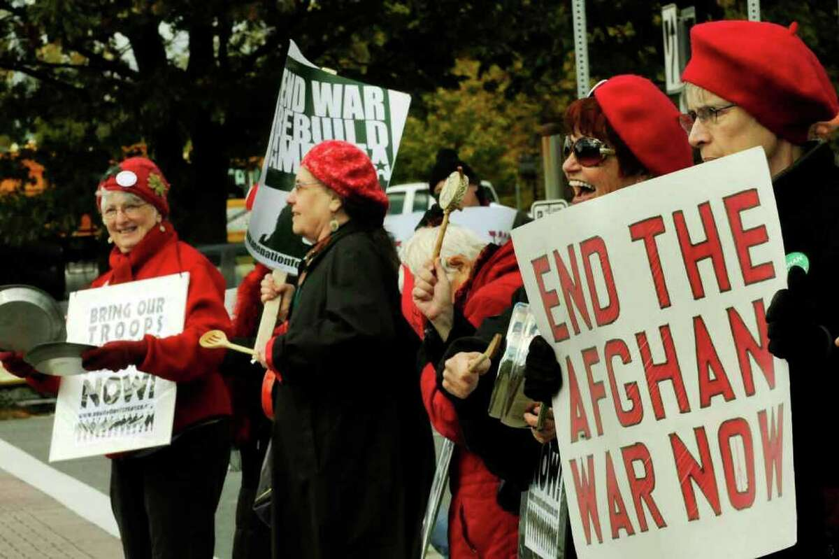 Local Grannies for Peace protest against war at the corner of Wolf Road and Central Avenue in Colonie on Saturday. They are criticizing the war's negative economic impact. (Michael P. Farrell / Times Union)
