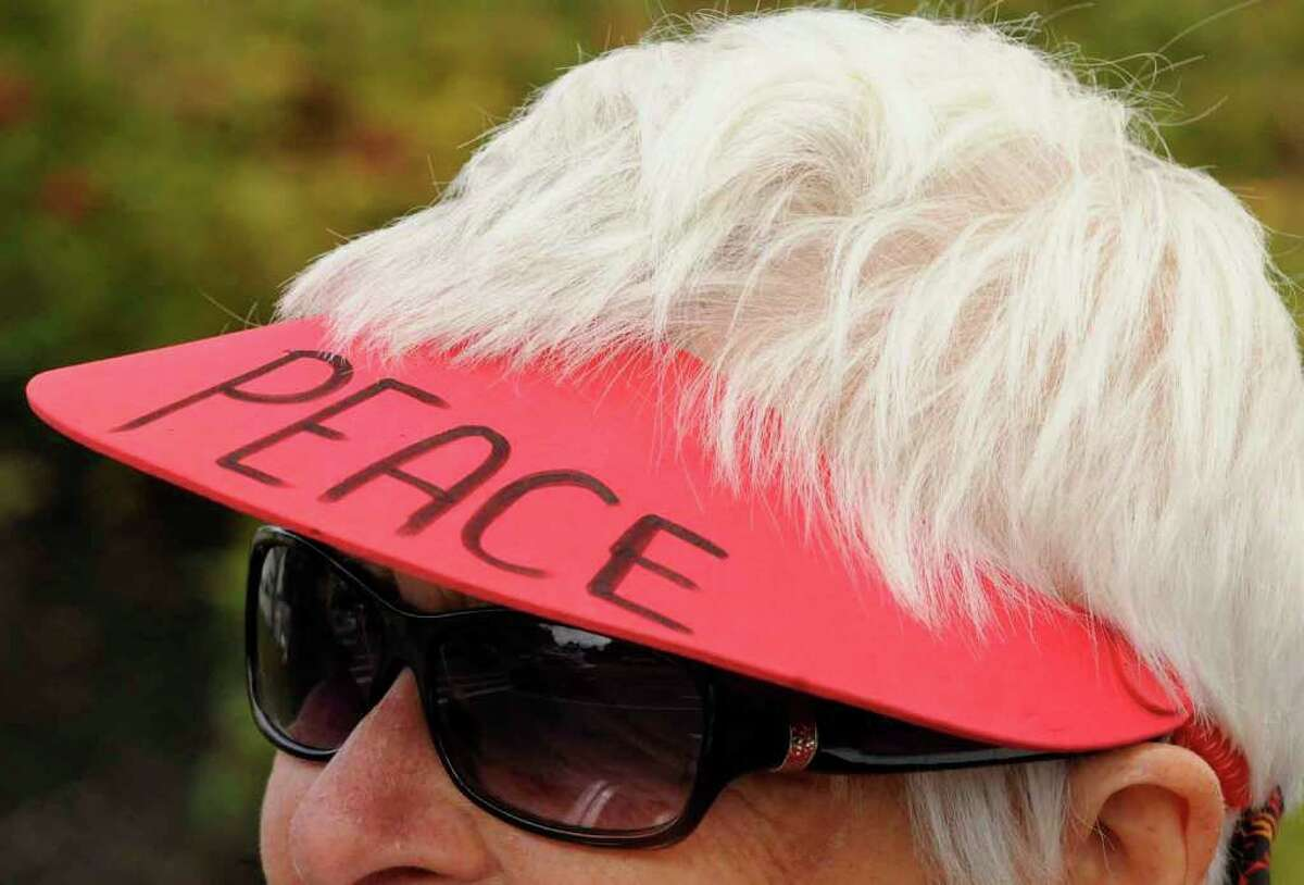 Pat Beetle of Castleton joins other Grannies for Peace as they protest against war at the corner of Wolf Road and Central Avenue in Colonie Saturday. (Michael P. Farrell / Times Union)