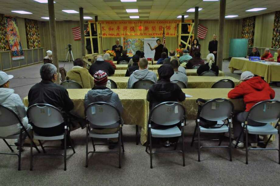 Holy Master Ziguang Shang Shi, also known as Lucas Wang, is leader of the World Peace and Health Organization, a Buddhist group. He   speaks at their Five Buddha Temple in the former St. Casimir's Church in Amsterdam, NY on Monday October 4, 2010, while leading a free, three day Health Dhama Course. The group has recently purchased 48 homes in Amsterdam in a foreclosure auction. (Philip Kamrass / Times Union ) Photo: Philip Kamrass