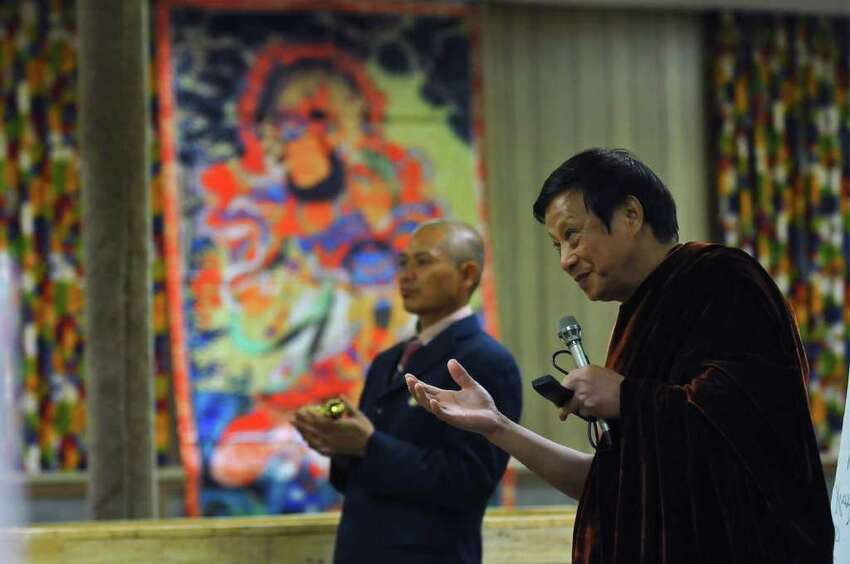 Holy Master Ziguang Shang Shi, also known as Lucas Wang, is leader of the World Peace and Health Organization, a Buddhist group. He speaks at their Five Buddha Temple in the former St. Casimir's Church in Amsterdam, NY on Monday October 4, 2010, while leading a free, three day Health Dhama Course. The group has recently purchased 48 homes in Amsterdam in a foreclosure auction. (Philip Kamrass / Times Union )