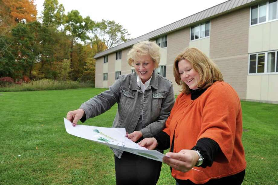 Dana Ford, left, principal of Schaghticoke Middle School in New Milford and Wendy LaCava, president of the PTO, look over plans for a courtyard at the school. Photo taken Friday, Oct. 15, 2010. Photo: Carol Kaliff / The News-Times