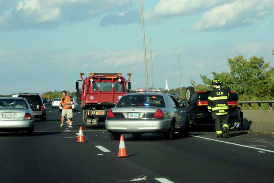 An overturned vehicle between exits 4 and 5, northbound, on I-95, on Sunday, Oct. 17, 2010. Photo: Helen Neafsey / Greenwich Time