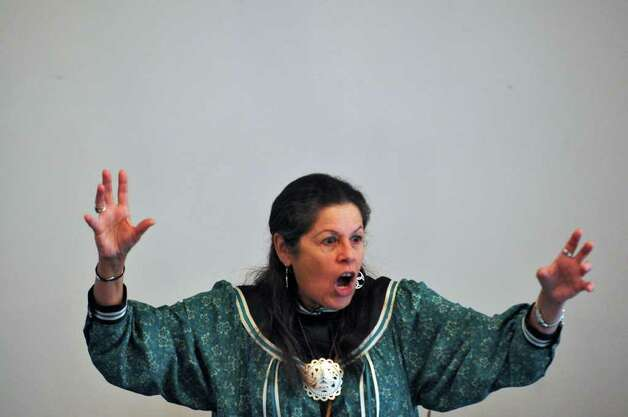 Kay Olan, of the Mohawk Nation, tells a scary tale Sunday as part of an Iroquois cultural presentation during Native New York Family Day at Brookside Museum in Ballston Spa. The storyteller lives in Saratoga Springs. ( Philip Kamrass / Times Union )
