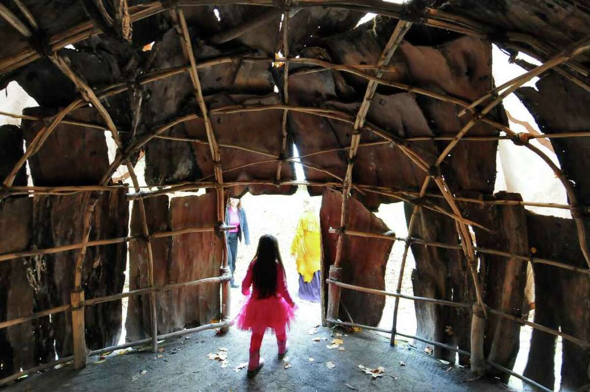Aurora Hope Hansen, 4, checks out a wigwam covered in elm bark Sunday during Native New York Family Day at Brookside Museum in Ballston Spa. ( Philip Kamrass / Times Union )