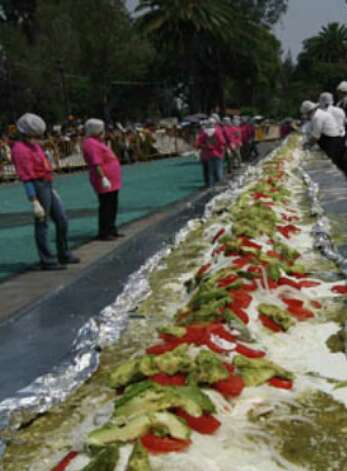 Chefs prepare the world's largest enchilada during the National Enchilada Fair at the neighborhood of Iztapalapa in Mexico City, Sunday.
