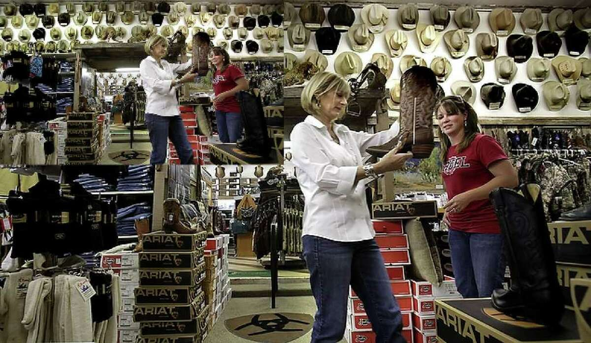 Jill Martin, left, owner of Ben's Western Wear in Cotulla, TX, helps Brandy Hehman, a regular at the store, find her size in a style of boot. Jill has a collection of over 450 hats from area land owners, ranchers and cowboys, Friday, Oct. 15, 2010.