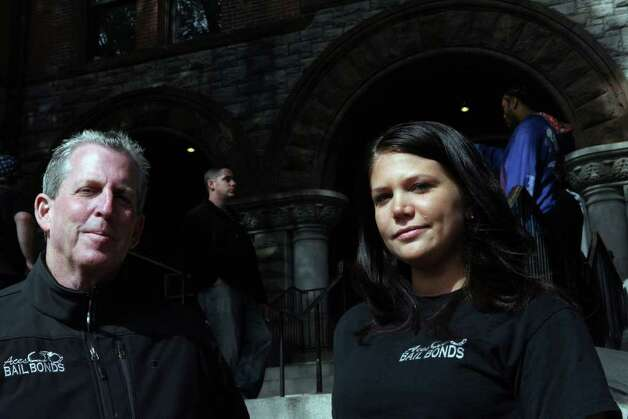 Dave Simons, owner of Aces Bail Bonds in Bridgeport, and agent Jenn McDowell stand in front of the courthouse on Golden Hill Street in Bridgeport. Simons subscribes to and teaches a code of ethics in the business. Photo: B.K. Angeletti / Connecticut Post