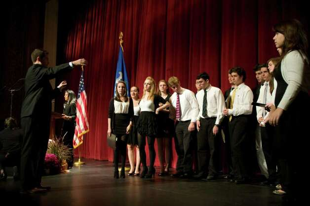 The Westhill High School Chamber Singers rehearse before First Lady Michelle Obama appeared with Connecticut Attorney General Richard Blumenthal, the Democratic candidate for U.S. Senate, at a campaign event at the Palace Theatre in Stamford, Conn. on Monday, Oct. 18, 2010. Photo: Dru Nadler / Stamford Advocate Freelance