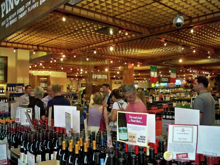 "Pictured is a wine-tasting at Stew Leonard's wine store in Norwalk.  The shop will hold its first ""sip and twit"" wine-tasting event on from 4 to 7 p.m. Firiday. Featuring Iron Horse wines from California, it will allow people to taste the wines and use their mobile devices to tweet the winery about the wine. Photo: Contributed Photo / Stamford Advocate Contributed"