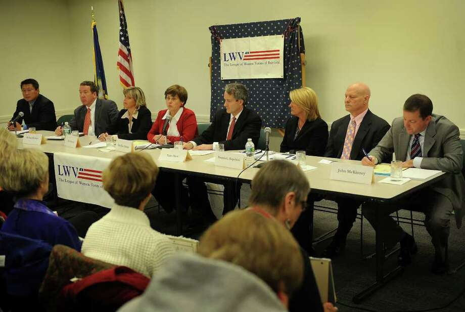 From left; State representative candidates Tony Hwang, Michael Murren, Kim Fawcett, DeeDee Brandt, Tom Drew, and Brenda Kupchick, and state senate candidates Mitchell Fuchs and John McKinney debate the issues at the Fairfield Public Library on Monday, October 18, 2010. Photo: Brian A. Pounds / Connecticut Post