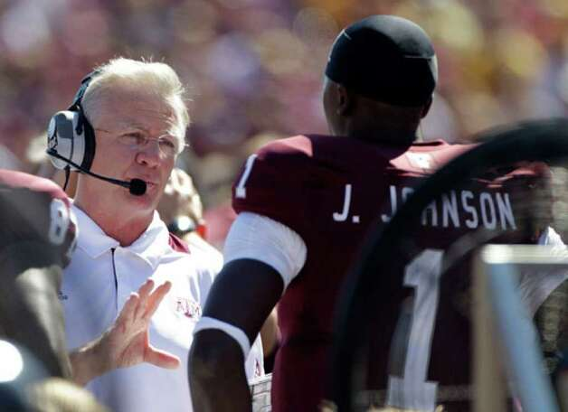 A&M's Mike Sherman (left) has been criticized for sticking with quarterback Jerrod Johnson.