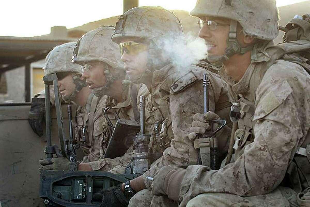 U.S. Marines Cpl. Kevin Ivie of Paris, Kentucky (left to right), Cpl. Sam Garcia of Taos, N.M., Cpl. Jorge Villarreal of San Antonio and Cpl. Jonathan Eckert of Oak Lawn, lll., in Kajaki, Afghanistan, on Oct. 17. Villarreal was killed Sunday.