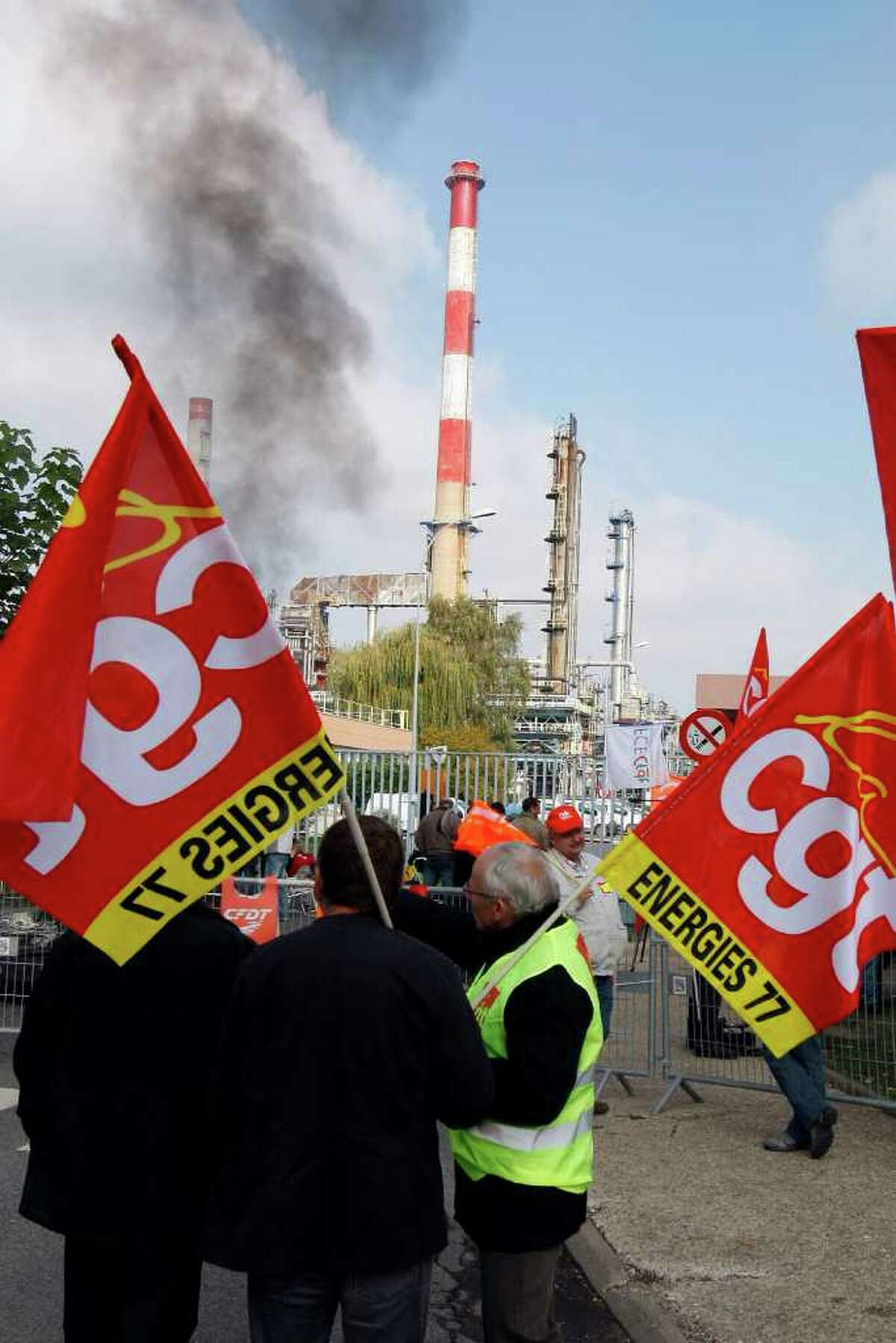 French Union workers block the entrance of the oil refinery of Grandpuits eastern of Paris, Monday, Oct. 18 , 2010. Some oil workers pledged to keep up a protest at refineries, and one union warned of looming gasoline shortages as an open-ended strike against President Nicolas Sarkozy's plan to raise the retirement age to 62 entered its seventh day. CGT on flags stands for General Confederation of Work union. (AP Photo/Francois Mori)