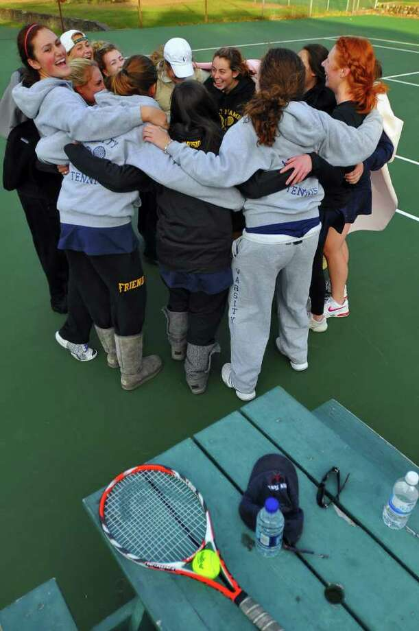 High school girls' tennis -- Members of the Academy of the Holy Names girls' tennis team celebrate their Class A sectional championship after beating Burnt Hills on Monday afternoon at Central Park in Schenectady. ( Philip Kamrass / Times Union ) Photo: Philip Kamrass