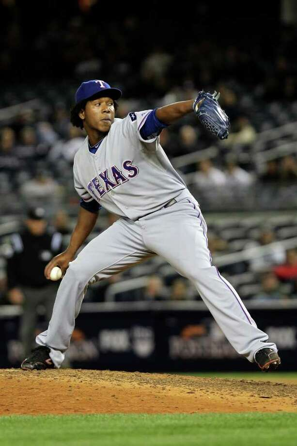 NEW YORK - OCTOBER 18:  Neftali Feliz #30 ofthe Texas Rangers pitches against the New York Yankees in Game Three of the ALCS during the 2010 MLB Playoffs at Yankee Stadium on October 18, 2010 in New York, New York. The Rangers won 8-0.  (Photo by Nick Laham/Getty Images) *** Local Caption *** Neftali Feliz Photo: Nick Laham, Getty Images / 2010 Getty Images