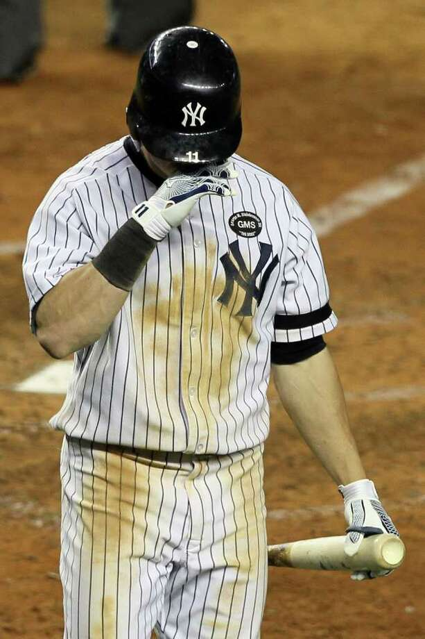 NEW YORK - OCTOBER 18:  Brett Gardner #11 of the New York Yankees reacts after striking out against the Texas Rangers in Game Three of the ALCS during the 2010 MLB Playoffs at Yankee Stadium on October 18, 2010 in New York, New York.  (Photo by Jim McIsaac/Getty Images) *** Local Caption *** Brett Gardner Photo: Jim McIsaac, Getty Images / 2010 Getty Images