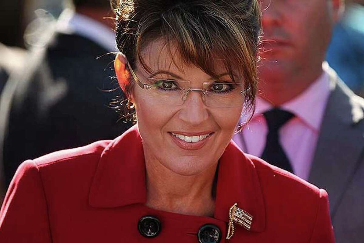 RENO, NV - OCTOBER 18: Politician and conservative activist Sarah Palin prepares to speak at the launch for the Tea Party Express national tour which is kicked off with a rally in Reno on October 18, 2010 in Reno, Nevada. The tour, part of an initiative to get conservatives elected to the House and Senate, will move across country and conclude on November 1, 2010 in Concord, New Hampshire the day before the contentious mid-term elections. (Photo by Spencer Platt/Getty Images) *** Local Caption *** sarah palin