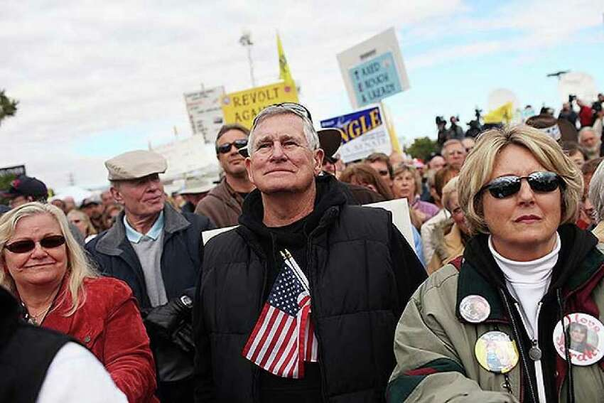 RENO, NV - OCTOBER 18: Tea Party supporters listen to speakers while attending the launch for the Tea Party Express national tour which kicked off with a rally in Reno on October 18, 2010 in Reno, Nevada. The tour, part of an initiative to get conservatives elected to the House and Senate, will move across country and conclude on November 1, 2010 in Concord, New Hampshire the day before the contentious Mid-Term elections. (Photo by Spencer Platt/Getty Images)