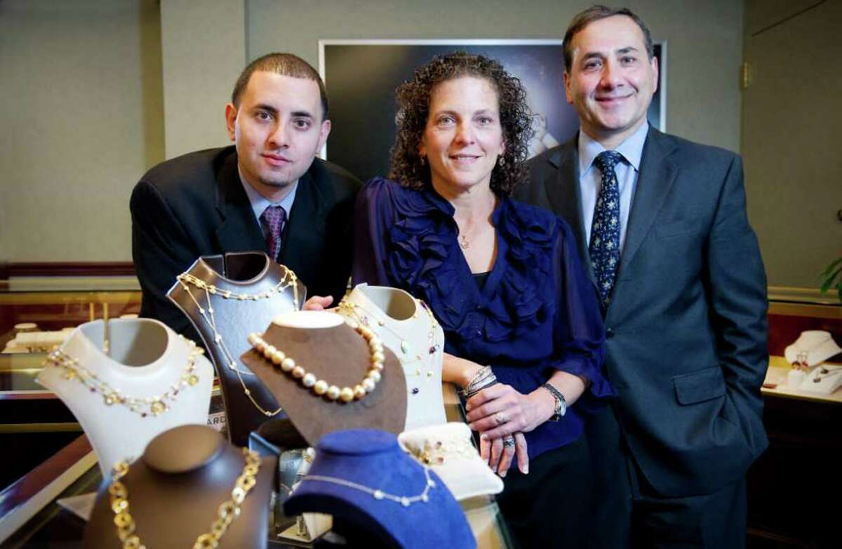 Liz Osta and her husband Nagi Osta, owners of Nagi Jewelers, with their son Jeffrey Osta at their Stamford, Conn. store on Tuesday October 19, 2010. They are finalists in the small business category for the UConn Family Business awards to be given on Dec. 1.