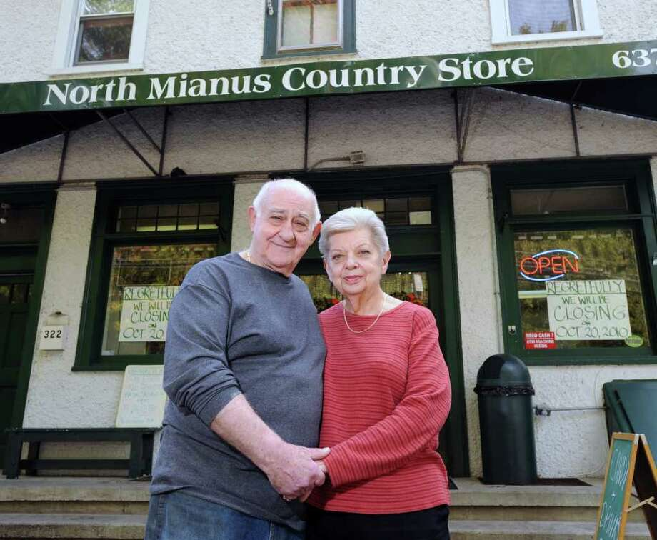 Tony Cozzolino and his wife, Carolyn, posed in front of the North Mianus Country Store at 322 Palmer Hill Road in the Mianus section of Greenwich, Tuesday afternoon, Oct. 19, 2010.  The store that they have run for the past two years will be closing Wednesday, Oct. 20, 2010.  The couple blames the bad economy and the town's insistence it have two bathrooms (it has one) because it has a few tables. They cannot afford the $8,000 for an additional bathroom. Photo: Bob Luckey / Greenwich Time