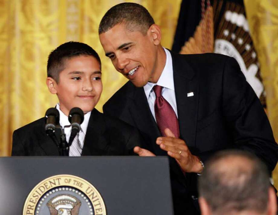 President Barack Obama is introduced by Javier Garcia, a seventh-grade Brownsville student who took part in the ceremony.